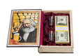 Casket in the form of books for money open book with picture karl marx and gold with two glasses and pack dollars isolated on a Royalty Free Stock Images