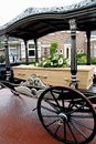 Casket on a funeral carriage wooden with flowerson Stock Images