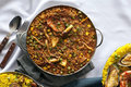 Casserole with paella on the table Royalty Free Stock Images