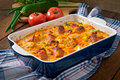 Casserole with sausage bacon and apples in a pumpkin cheese sauce Stock Image