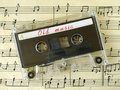 Cassette on old sheet music Stock Images