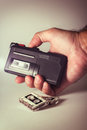Cassette recorder microcassette in a hand with tapes Stock Photo