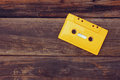Cassette tape over wooden table. top view. image is retro filtered. room for text Royalty Free Stock Photo