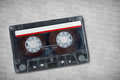 Cassette tape on textured background Royalty Free Stock Photo