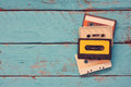 Cassette tapes over blue textured wooden table top view retro filter Stock Image