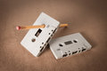 Cassette tapes with pencil for rewind on brown paper background vintage style Stock Images
