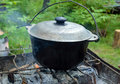 Cast iron pot with lid for cooking over an open fire Stock Image