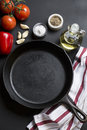 Cast Iron Skillet with copy area on black background with ingredients Royalty Free Stock Photo