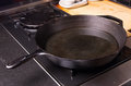 Cast iron skillet or fry pan on stove Stock Images