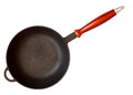Cast iron skillet with wooden handle Royalty Free Stock Photo