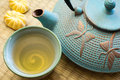 Cast iron tea pot with tea cup and sweets Royalty Free Stock Photo