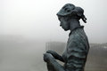 Cast statue of fisherwoman in bridlington on harbour pier Royalty Free Stock Images