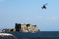 Castel dell ovo the old castle at naples in italy with a helicopter in the sky Stock Photography
