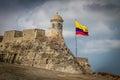 Castillo de San Felipe and colombian flag - Cartagena, Colombia Royalty Free Stock Photo