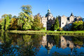 Castle Bueckeburg reflecting in the moat Royalty Free Stock Photo