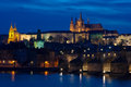 Castle and Charles Bridge by night in Prague Royalty Free Stock Photo