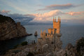 Castle on a cliff in the evening light Royalty Free Stock Photo