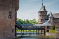 Castle de haar the netherlands with its connectimg bridge connecting at a medieval fortress towers ramparts canals and drawbridges Stock Photo