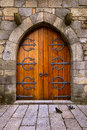 Castle door beautiful old wooden with iron ornaments in a medieval Royalty Free Stock Photos