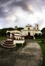 The castle and the dragon a cloud hovering above a church in batanes Stock Photography