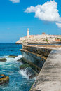 The castle of el morro in havana and famous wall malecon with white puffy clouds on a blue sky Stock Photography
