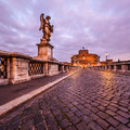 Castle of holy angel and holy angel bridge over the tiber river in rome at dawn italy Royalty Free Stock Images