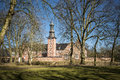 Castle husum caslte with trees and blue sky on a sunny day in spring Stock Photos