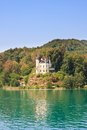 Castle on lake worth in carinthia austria view of Stock Image