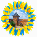Castle in Lutsk framed with petals in colors of Ukrainian flag Royalty Free Stock Photo