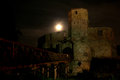 Castle at night with a full moon Royalty Free Stock Images