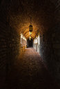 Castle passageway gloomy brick with an arched roof in an old Royalty Free Stock Photo