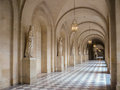 Castle passageway in a medieval french under arches and in front of a row of stone statures Stock Photos