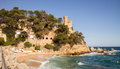 Castle on a rock overlooking the sea Royalty Free Stock Photo