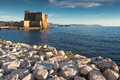 Castle on the sea naples italy view of ancient known as castel dell ovo in shot in a nice afternoon light background coast of Stock Images