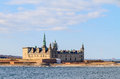 Castle on the shores of oresund helsingor shot from strait a cloudy day Stock Images