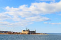 Castle on the shores of oresund helsingor shot from strait a cloudy day Royalty Free Stock Photography