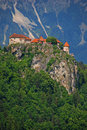 Castle at the top of the hill overlooking lake bled Stock Photos