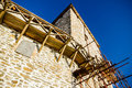 Castle tower in reconstruction old with scaffolding under construction Royalty Free Stock Photo