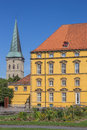 Castle and the tower of st katharinen church in osnabruck germany Royalty Free Stock Image