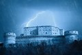Castle under the storm lightning over in night Royalty Free Stock Photography