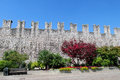 Castle wall in the city park medieval historical landmark example of medieval fortification Royalty Free Stock Photo