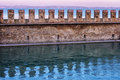 Castle wall in water in italy a reflecting the at lake garda Stock Photo