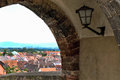 Castle window with lamp overlooking German city Royalty Free Stock Photo