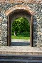 Castle wooden door leading to garden