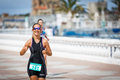 CASTRO URDIALES, SPAIN - SEPTEMBER 17: Unidentified triathlete woman in the running competition celebrated in the triathlon of Cas Royalty Free Stock Photo