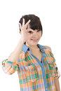 Casual asian woman doing the ok sign on eye young isolated white background Stock Photography