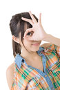 Casual asian woman doing the ok sign on eye young isolated white background Stock Photo