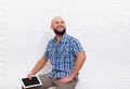 Casual Bearded Man Stand Holding Tablet Computer Look Up To Copy Space Royalty Free Stock Photo