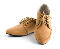 Casual brown leather unisex shoes lady on white Royalty Free Stock Image