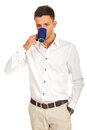 Casual business man drinking coffee isolated on white background Royalty Free Stock Photos